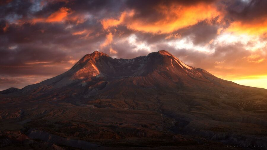 Mt St Helens at sunset surrounded by orange clouds